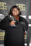 US actress Gabourey Sidibe poses with her award in the press room at the 25th Independent Spirit Awards held at the Nokia Theater in Los Angeles on March 5, 2010. The Independent Spirit Awards is a celebration honoring films made by filmmakers who embody independence and originality..Photo by Nina Prommer/Milestone Photo