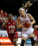 VERMILLION, SD - MARCH 27, 2016 -- Kelly Stewart #15 of South Dakota drives past Tashia Brown #10 of Western Kentucky during their WNIT game Sunday evening at the Dakotadome in Vermillion, S.D.  (Photo by Dick Carlson/Inertia)