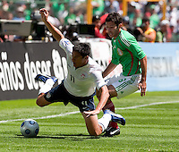 Brian Ching is fouled. USA Men's National Team loses to Mexico 2-1, August 12, 2009 at Estadio Azteca, Mexico City, Mexico. .   .