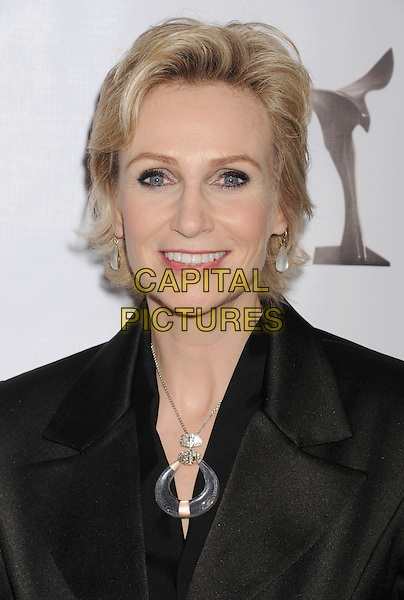 Jane Lynch.2013 WGA Writers Guild Awards held at JW Marriott Los Angeles at L.A. LIVE, Los Angeles, California, USA..February 17th, 2013.headshot portrait clear circle necklace black  .CAP/ROT/TM.©Tony Michaels/Roth Stock/Capital Pictures