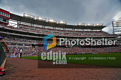24 May 2009: The lights come on at Nationals Park as the skys darken during a game against the Baltimore Orioles in Washington, DC. The Nationals rallied to defeat the Orioles 8-5 and salvage a win in their interleague series. Mandatory Credit: Ed Wolfstein Photo
