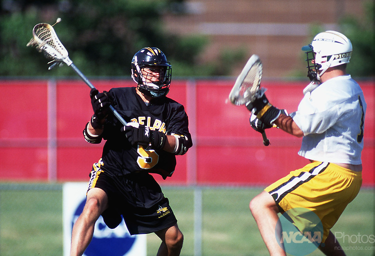 24 May 1998: Jamie Miceli (5) of Adelphi sets his eyes on the goal before scoring through  C.W. Post goalie Vin Fredericks (1) during the Division 2 Men's Lacrosse Championships at the Soccer/Lacrosse Stadium at Yurcak Field in Piscataway, NJ.  Miceli scored 4 goals and Adelphi defeated C.W. Post 18-6 for the championship.  John Munson/NCAA Photos.