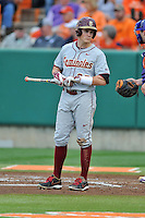 Florida State Seminoles center fielder Brent Knief #25 looks to the dugout for signals during a game against the Clemson Tigers at Doug Kingsmore Stadium on March 22, 2014 in Clemson, South Carolina. The Seminoles defeated the Tigers 4-3. (Tony Farlow/Four Seam Images)