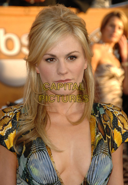 ANNA PAQUIN.Arrivals at the 16th Annual Screen Actors Guild Awards Held At The Shrine Auditorium in Los Angeles, California, USA..January 23rd, 2010 .SAG SAGs headshot portrait low cut print cleavage plunging neckline pattern printed blue snake green yellow gold .CAP/RKE/DVS.©DVS/RockinExposures/Capital Pictures
