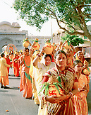 INDIA, Jaipur, festival with woman carrying pots on their heads