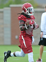 NWA Democrat-Gazette/MICHAEL WOODS &bull; @NWAMICHAELW<br /> University of Arkansas running back Alex Collins runs drills during the Arkansas Razorbacks practice Thursday August 6, 2015 in Fayetteville.