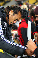 Tana Umaga signs autographs after the game. Super 15 rugby match - Hurricanes v Chiefs at Westpac Stadium, Wellington, New Zealand on Saturday, 12 March 2011. Photo: Dave Lintott / lintottphoto.co.nz