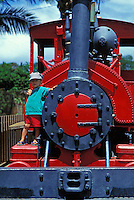 Little boy standing proudly on the Sugar Cane train, Ewa, central Oahu.