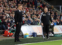 Pictured L-R: Swansea manager Garry Monk and West Ham manager Neil McDonald Saturday 10 January 2015<br />