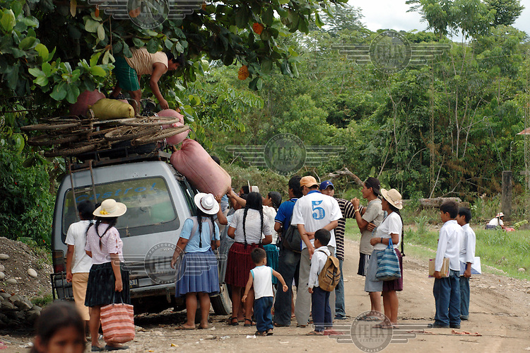 Villagers load sacks of coca onto a van to go to the market.  The village was once home to President Evo Morales when he was a farmer and leader of the Coca Growers' Union. While Morales remains in power, each family is permitted to grow coca on a 40 metre square plot of land.Photo: Dermot Tatlow/Panos Pictures/Felix Features