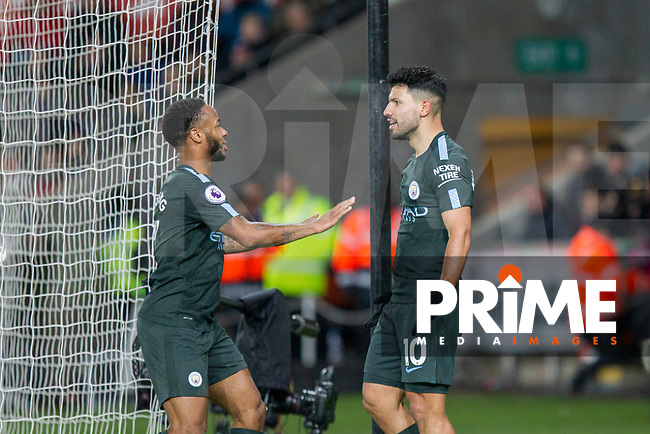 Sergio Aguero of Manchester City celebrates scoring his side's fourth goal with Raheem Sterling during the EPL - Premier League match between Swansea City and Manchester City at the Liberty Stadium, Swansea, Wales on 13 December 2017. Photo by Mark  Hawkins / PRiME Media Images.