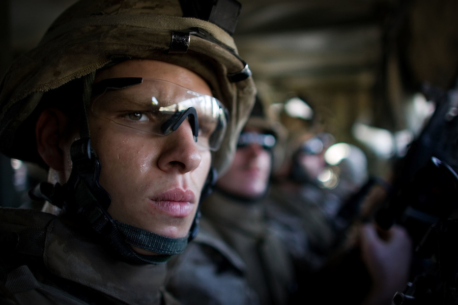 Marines from Alpha Co. 1st Battalion 6th Marines ride warily through the streets of Ramadi, Iraq on Fri. Oct. 13, 2006.<br />
