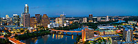Aerial Austin View Panorama - Another aerial view down Lady Bird Lake or town lake looking east along the shoreline at twilight. Along this view you can see the Austonian, the Frost, One Capital, Ashton, Hyatt Hotel, American Stateman plus the new Fairmont Hotel. You see the Congress bridge and part of the first street bridge as the colorado river as it flows down stream to the coast.