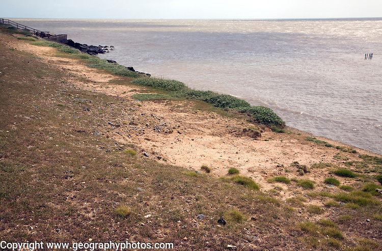 Scouring  erosion caused by wave backwash on top of sea wall, East Lane, Bawdsey, Suffolk, England