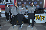 (L-R) Traveon Redd, Zeek Rodney, and Wendell Dunn of the Wake Forest Demon Deacons pose for a photo in front of a NASCAR race car in Victory Circle at the Charlotte Motor Speedway on December 26, 2017 in Concord, North Carolina.  (Brian Westerholt/Sports On Film)