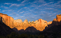 Sunrise, Clouds and silhouetted ridge of the Towers of the Virgin, Zion National Park, Utah.