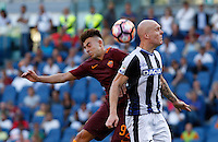 Calcio, Serie A: Roma vs Udinese. Roma, stadio Olimpico, 20 agosto 2016.<br /> Roma&rsquo;s Stephan El Shaarawy, left, and Udinese&rsquo;s Emil Hallfredsson jump for the ball during the Italian Serie A football match between Roma and Udinese at Rome's Olympic Stadium, 20 August 2016. Roma won 4-0.<br /> UPDATE IMAGES PRESS/Riccardo De Luca