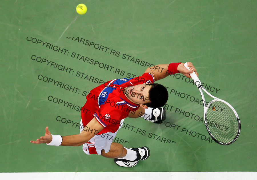Novak Djokovic of Serbia serve the ball to Gael Monfils of France during their Davis Cup finals tennis match in Belgrade, Serbia, Sunday, Dec. 5, 2010. (credit & photo: Srdjan Stevanovic/Starsportphoto.com)