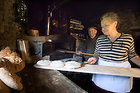 Tiroler Oberland, Tyrol, Austria, June 2009. A Woman and her husband bake traditional bread in the wood oven of the Greiter Muehle mill. Traditional life still plays a big role in the village of Greit. The Region of the Tyrolian Highlands offer many different options for outdoor adventures, leisure and relaxing. Photo by Frits Meyst/Adventure4ever.com