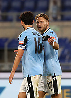 Football, Serie A: S.S. Lazio - Cagliari, Olympic stadium, Rome, July 23, 2020. <br /> Lazio's Ciro Immobile (r) celebrates with his teammate Marco Parolo (l) after scoring during the Italian Serie A football match between Lazio and Cagliari at Rome's Olympic stadium, Rome, on July 23, 2020. <br /> UPDATE IMAGES PRESS/Isabella Bonotto