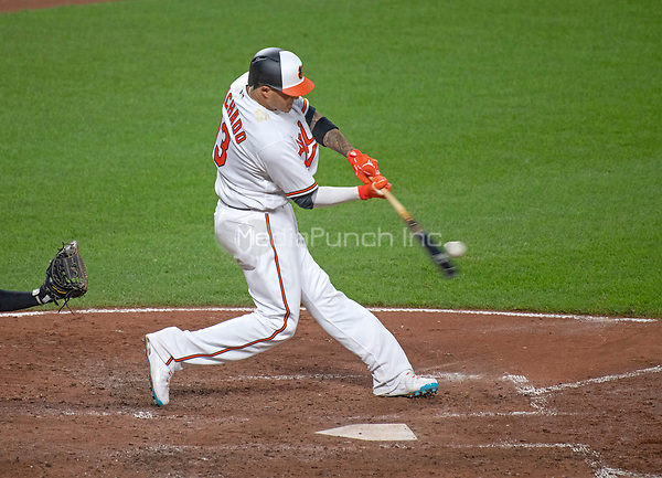 Baltimore Orioles shortstop Manny Machado (13) connects for a solo home run in the fifth inning against the New York Yankees at Oriole Park at Camden Yards in Baltimore, MD on Tuesday, July 10, 2018.<br /> Credit: Ron Sachs / CNP<br /> (RESTRICTION: NO New York or New Jersey Newspapers or newspapers within a 75 mile radius of New York City) Credit: Ron Sachs/MediaPunch