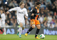 Real Madrid's Luka Modric against Valencia's Ever Banega during King's Cup match. January 15, 2013. (ALTERPHOTOS/Alvaro Hernandez) /NortePhoto