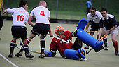 Hockey - Subway Eat Fresh Mens National League Div 1 - Western Wildcats V Menzieshill at Auchenhowie, Milngavie - Menzieshill goalkeeper Andrew Ross defends the ball as Wildcats (in white) press home an attack in their 6-1 victory - Picture by Donald MacLeod 05.09.09
