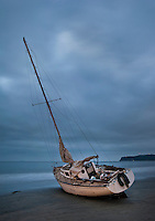 An abandoned Sailboat washed ashore in Coronado, Calif.