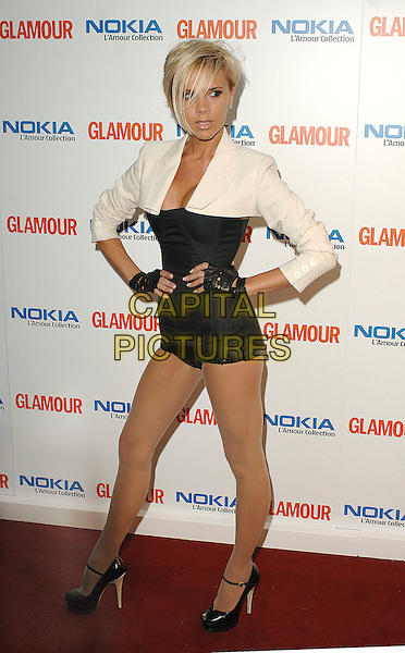 VICTORIA BECKHAM.attending the Glamour Women Of The Year Awards, Berkeley Square Gardens, London, 5th June 2007..full length white cream cropped shirt jacket black all-in-one playsuit corset hotpants shorts gloves hands on hips YSL Yves Siant Laurent Tribute pumps Mary Jane ankle strap shoes platforms peep-toes  .CAP/BEL.©Tom Belcher/Capital Pictures.