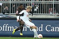 Football: Germany, 2. Bundesliga.FC St. Pauli - FC Energie Cottbus.Joseph Claude Gyau (Fc St Pauli) - Michael Schulze (FC Energie Cottbus).?Ǭ© pixathlon