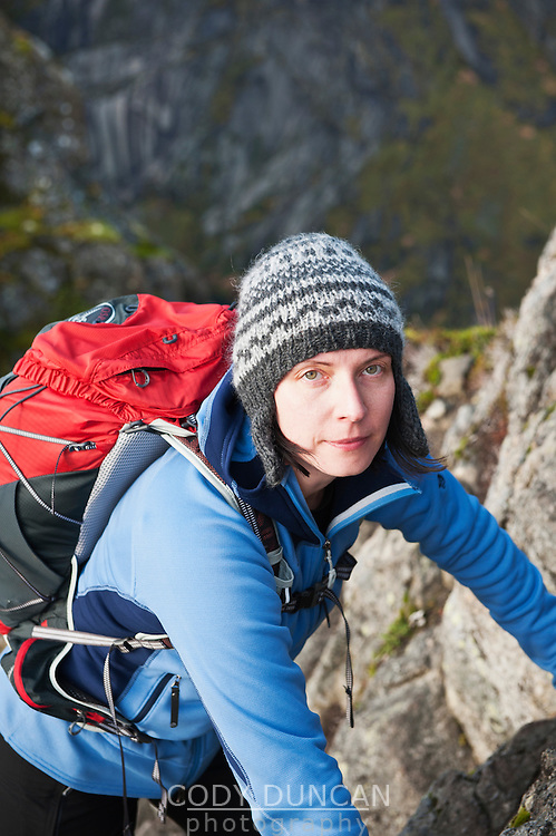 Portrait of female hiker looking into camera