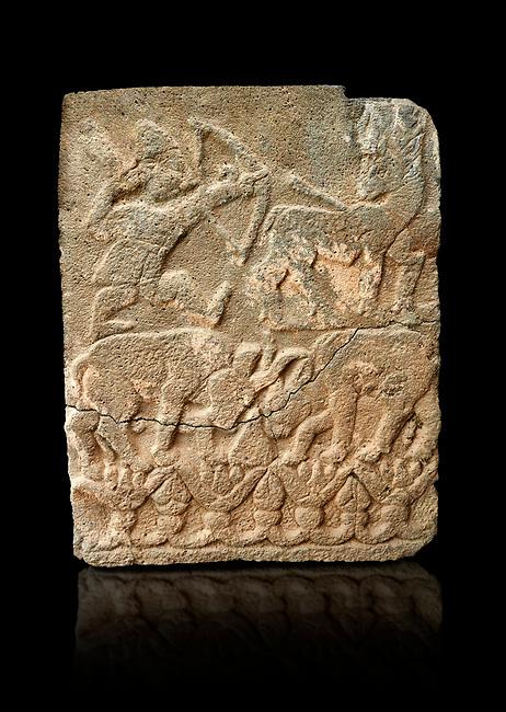 Pictures & images of the North Gate Hittite sculpture stele depicting Hittite hunting. 8th century BC. Karatepe Aslantas Open-Air Museum (Karatepe-Aslantaş Açık Hava Müzesi), Osmaniye Province, Turkey. Against black background