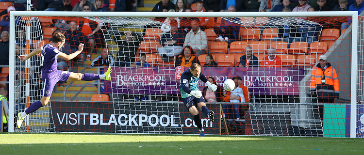 Blackpool's goalkeeper Jak Alnwick clears as Portsmouth's John Marquis attempts to block<br /> <br /> Photographer Stephen White/CameraSport<br /> <br /> The EFL Sky Bet League One - Blackpool v Portsmouth - Saturday 31st August 2019 - Bloomfield Road - Blackpool<br /> <br /> World Copyright © 2019 CameraSport. All rights reserved. 43 Linden Ave. Countesthorpe. Leicester. England. LE8 5PG - Tel: +44 (0) 116 277 4147 - admin@camerasport.com - www.camerasport.com