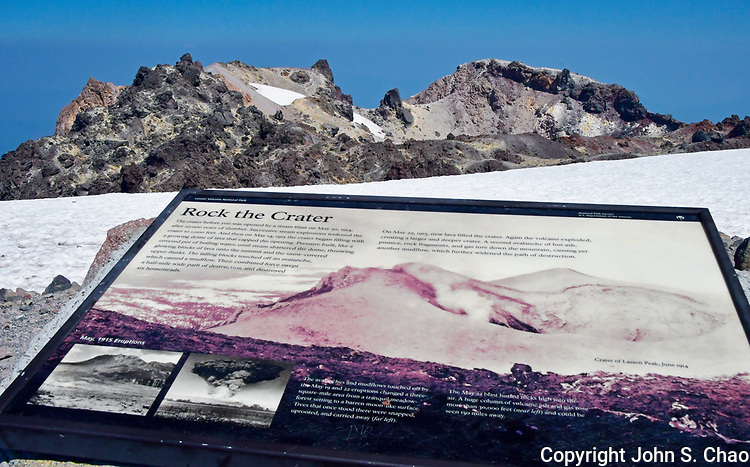 Lassen Peak summit (elevation 10,463 feet), volcanic crater with yellow sulphur deposits and Interpretive Sign, Lassen Volcanic National Park, California