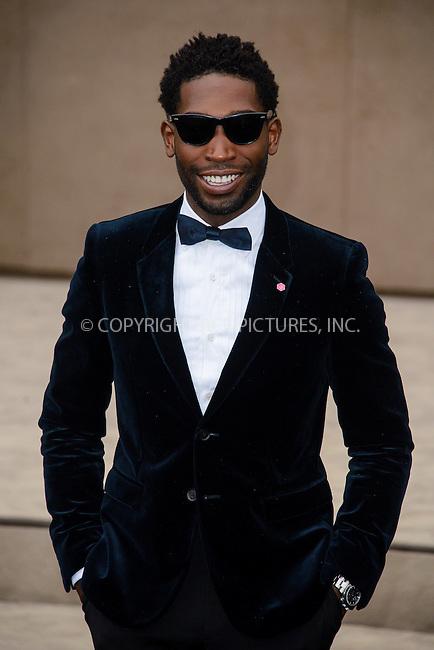WWW.ACEPIXS.COM<br /> <br /> January 12 2015, London<br /> <br /> Tinie Tempah attends the Burberry Prorsum Menswear A/W 2015 in Kensington Gardens on January 12 2015 in London<br /> <br /> <br /> By Line: Famous/ACE Pictures<br /> <br /> <br /> ACE Pictures, Inc.<br /> tel: 646 769 0430<br /> Email: info@acepixs.com<br /> www.acepixs.com