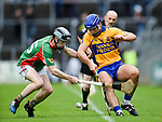 James Corry of  Clooney-Quin in action against Caimin Morey of  Sixmilebridge during their senior county final at Cusack Park. Photograph by John Kelly.