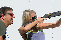 NWA Democrat-Gazette/FLIP PUTTHOFF <br /> Steve Dunlap with the Arkansas Game and Fish Commission watches Lindsey Frische shoot clay targets Oct. 7, 2015 during the outdoor education field trip.