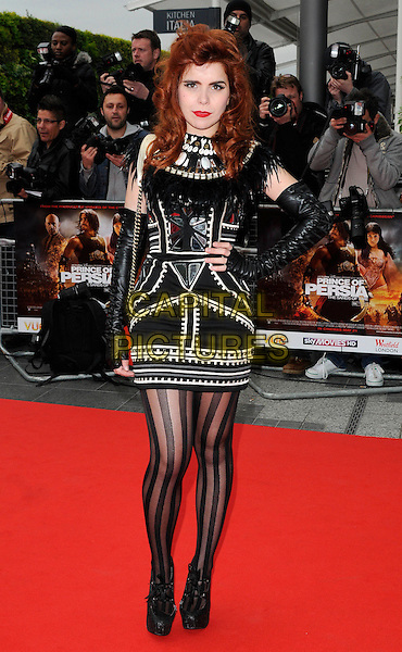 """PALOMA FAITH .At the World Film Premiere of """"Prince of Persia: The Sands Of Time"""", Vue cinema at Westfield shopping centre, London, England, 9th May 2010..arrivals full length black leather sleeves arm warmers dress striped tights white patterned pattern  feathers feather embellished silver metal fingerless gloves shells collar neckline .CAP/CAN.©Can Nguyen/Capital Pictures."""