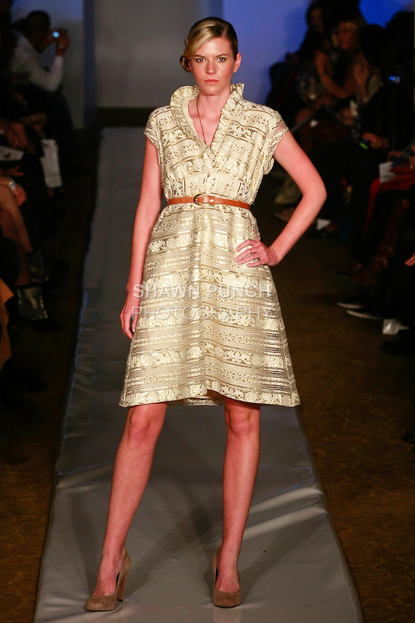Model walks runway in an outfit from the Ively's Closet fashion show, by Ively Hall, at Plitzs Fashion Week New York, during New York Fashion Week Fall 2012.