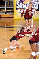17 November 2011:  Denver outside hitter/defensive specialist Kate Acker (5) dives for a dig in the second set as the FIU Golden Panthers defeated the Denver University Pioneers, 3-1 (25-21, 23-25, 25-21, 25-18), in the first round of the Sun Belt Conference Tournament at U.S Century Bank Arena in Miami, Florida.