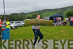 Sheaf-throwing at the Kilgarvan show on Sunday which saw young and old compete. Pictured is Francis Egan taking part.