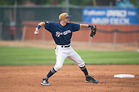 Helena Brewers infielder Brice Turang (18) throws to first base during a Pioneer League game against the Grand Junction Rockies at Kindrick Legion Field on August 19, 2018 in Helena, Montana. The Grand Junction Rockies defeated the Helena Brewers by a score of 6-1. (Zachary Lucy/Four Seam Images)