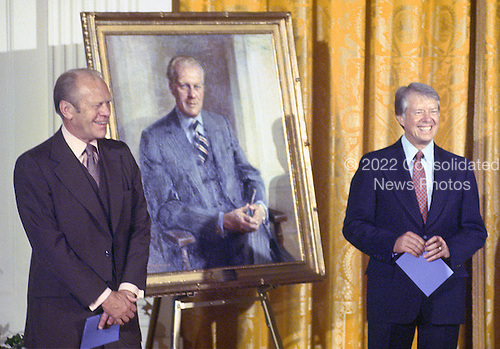 United States President Jimmy Carter, right, and former US President Gerald R. Ford, left, pose next to the portrait of President Ford that was unveiled during a ceremony  in the East Room of the White House in Washington, DC on August 4, 1980. The painting of the President and first lady will be on permanent display at the White House along with those of other US Presidents and first ladys.  <br /> Credit: Benjamin E. &quot;Gene&quot; Forte / CNP