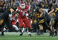 NWA Media/Michael Woods --11/28/2014-- w @NWAMICHAELW...Missouri running back Ruessell Hansbrough runs for a gain past Arkansas defender JaMichael Winston in the 4th quarter of Friday afternoons game at Faurot Field in Columbia Missouri.