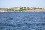 Boat trip to the Aran Islands passing small island of Inish Oirr County Clare Ireland