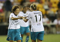 Aya Miyama #24 of Marta's XI congratulates Amy Rodriguez #17 after she scored during the WPS All-Star game against Abby's XI at the KSU Stadium in Kennesaw, Georgia on June 30 2010. Marta XI won 5-2.