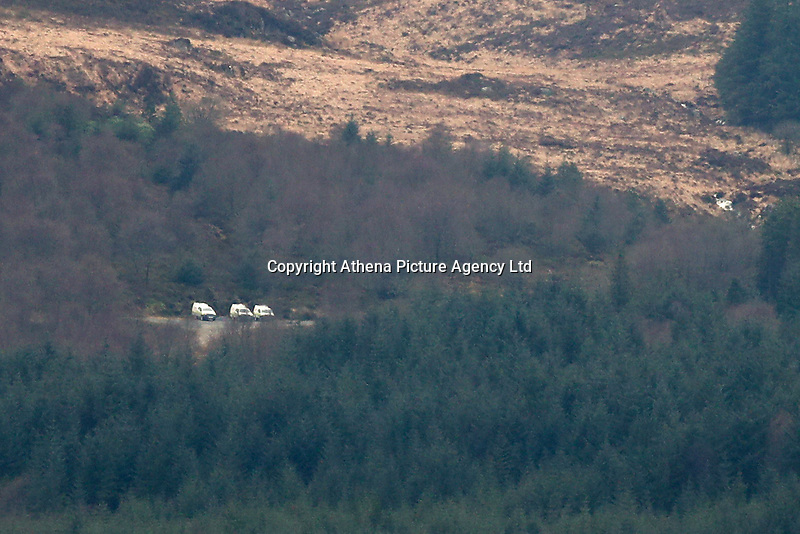 Pictured: Emergency vehicles in the far distance pinpoint the location where the helicopter crashed in Rhinog Mountains, Snowdonia, North Wales. Thursday 30 March 2017<br /> Re: Five people have been killed in a helicopter crash in north Wales.<br /> An air and land search was launched on Wednesday afternoon after the aircraft vanished en route from Luton to Dublin.<br /> The crash site was in the Rhinog mountains between Harlech and Trawsfynydd, and the bodies of all five people on board had been found by a mountin rescue team.