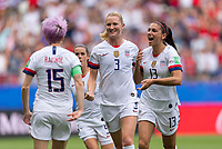 REIMS,  - JUNE 24: Megan Rapinoe #15 celebrates her goal with Kelley O'Hara #5, Sam Mewis #3 and Alex Morgan #13 during a game between NT v Spain and  at Stade Auguste Delaune on June 24, 2019 in Reims, France.