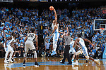 Doral Moore (4) of the Wake Forest Demon Deacons battles for the opening tip against Garrison Brooks (15) of the North Carolina Tar Heels at the Dean Smith Center on December 30, 2017 in Chapel Hill, North Carolina.  The Tar Heels defeated the Demon Deacons 73-69.  (Brian Westerholt/Sports On Film)
