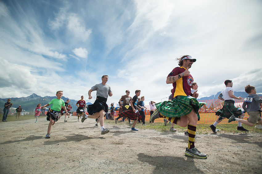"""Runners compete in the """"Kilted Mile"""" during the 2015 Alaska Scottish Highland Games at the Palmer fairgrounds."""